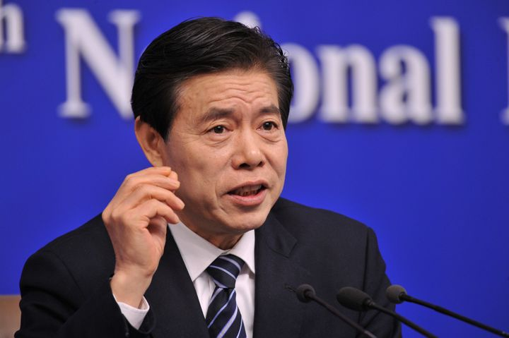 Chinese Commerce Minister Zhong Shan attends a news conference on the sidelines of the National People's Congress (NPC) in Be