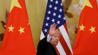 U.S. President Donald Trump waves during joint statements with China's President Xi Jinping at the Great Hall of the People in Beijing, China, November 9, 2017.  REUTERS/Thomas Peter