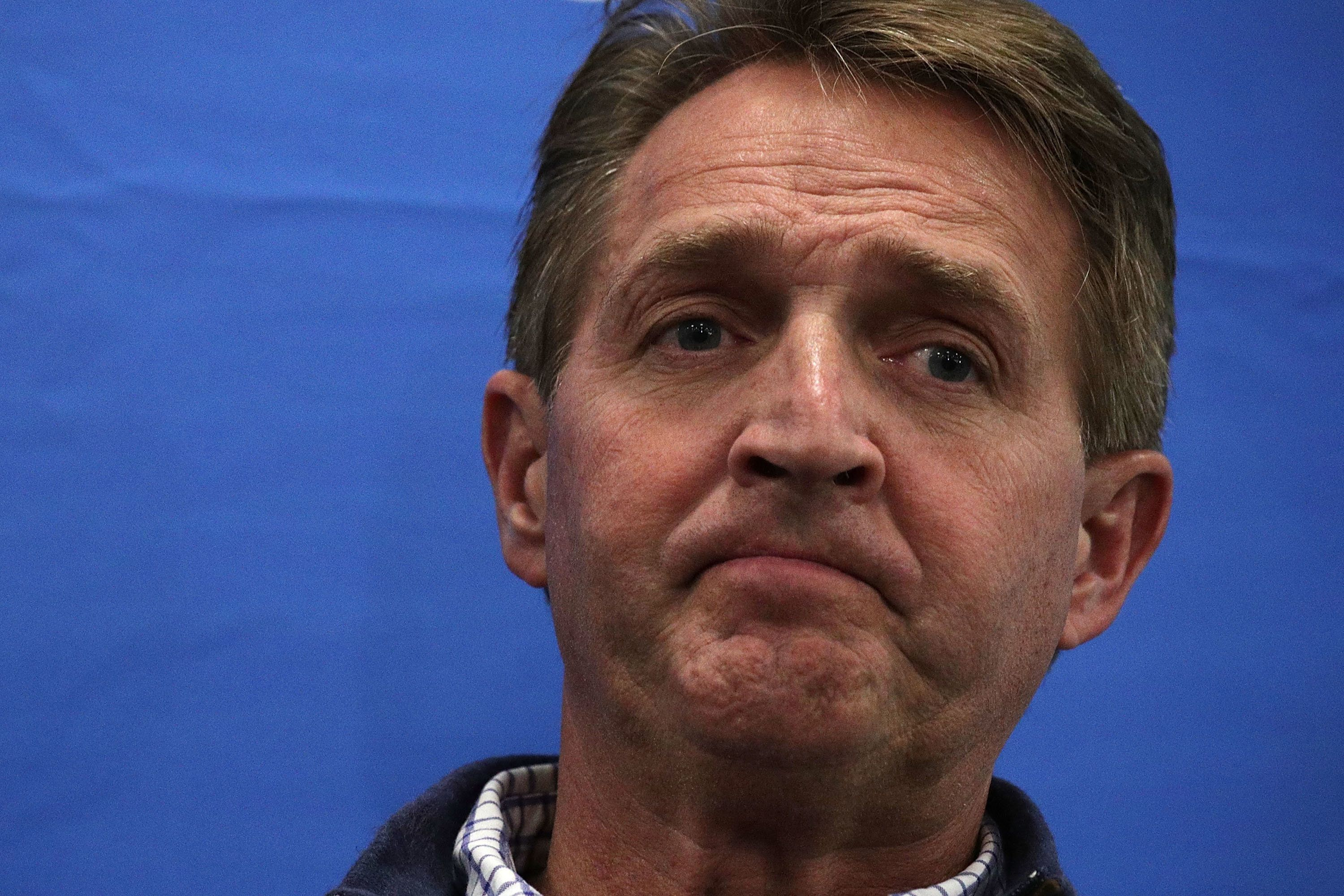 WHITE SULPHUR SPRINGS, WV - JANUARY 31:  U.S. Sen. Jeff Flake (R-AZ) attends a news briefing with other GOP lawmakers to discuss the train accident while they were on their way to the 2018 House & Senate Republican Member Conference January 31, 2018 in White Sulphur Springs, West Virginia. An Amtrak charted train that was bringing Republican lawmakers to their annual retreat crashed into a garbage truck near Crozet, Virginia, this morning killing one person on the truck.  (Photo by Alex Wong/Getty Images)