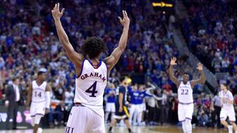 Senior Devonte' Graham and the Kansas Jayhawks celebrate an 81-70 win against West Virginia in the Big 12 Tournament championship game at the Sprint Center in Kansas City, Mo., on Saturday, March 10, 2018. (Rich Sugg/Kansas City Star/TNS via Getty Images)