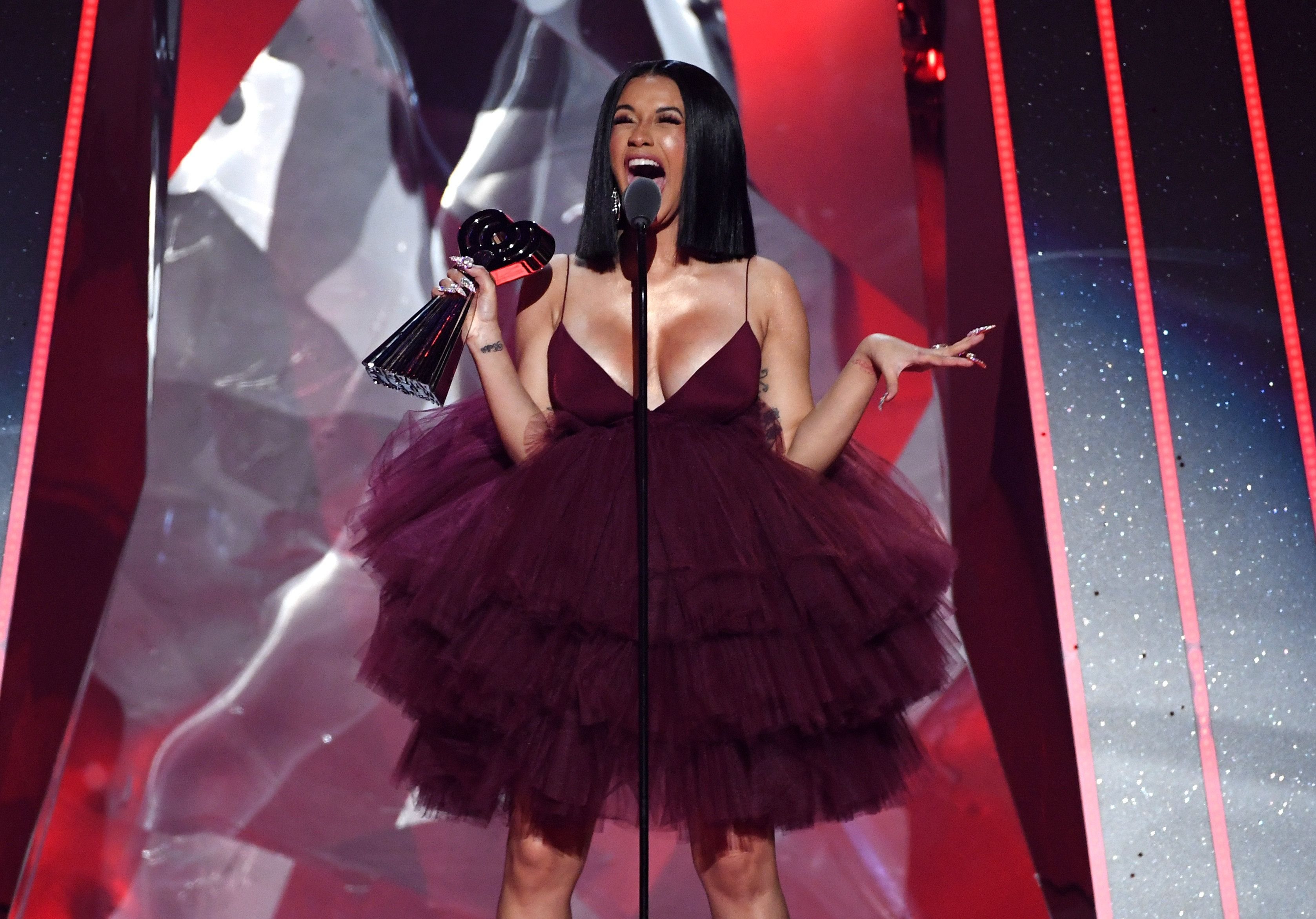 INGLEWOOD, CA - MARCH 11:  Cardi B accepts Best New Artist onstage during the 2018 iHeartRadio Music Awards which broadcasted live on TBS, TNT, and truTV at The Forum on March 11, 2018 in Inglewood, California.  (Photo by Kevin Winter/Getty Images for iHeartMedia)