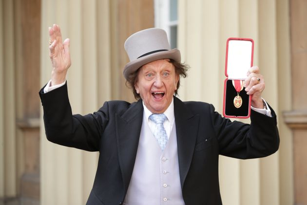 Ken Dodd after being knighted by Prince William last