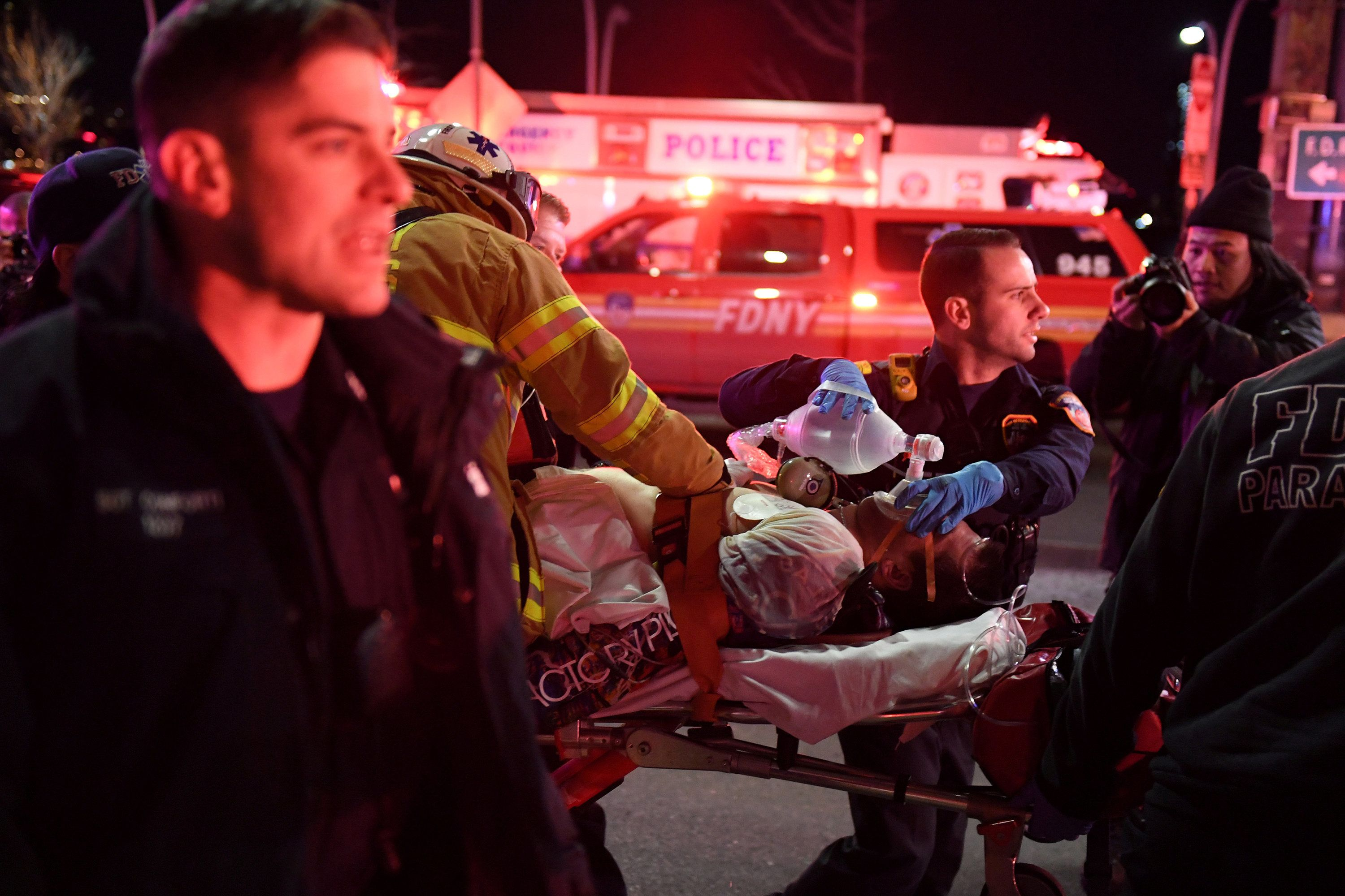 Paramedics and members of the NYFD perform CPR on a victim of a helicopter crash in New York City on Sunday.
