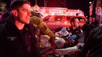 Paramedics and members of the NYFD perform CPR on a victim of a helicopter crash in New York, U.S., March 11, 2018. REUTERS/Darren Ornitz     TPX IMAGES OF THE DAY