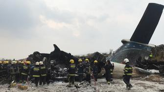 Wreckage of an airplane is pictured as rescue workers operate at Kathmandu airport, Nepal March 12, 2018. REUTERS/ Navesh Chitrakar
