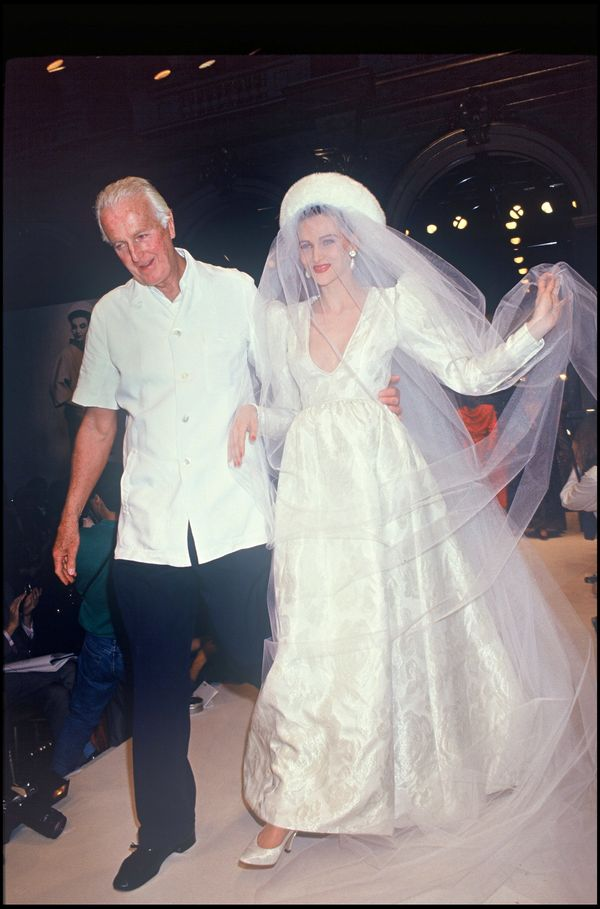 Givenchy with a model during his spring/summer 1992-1993 couture show in Paris.