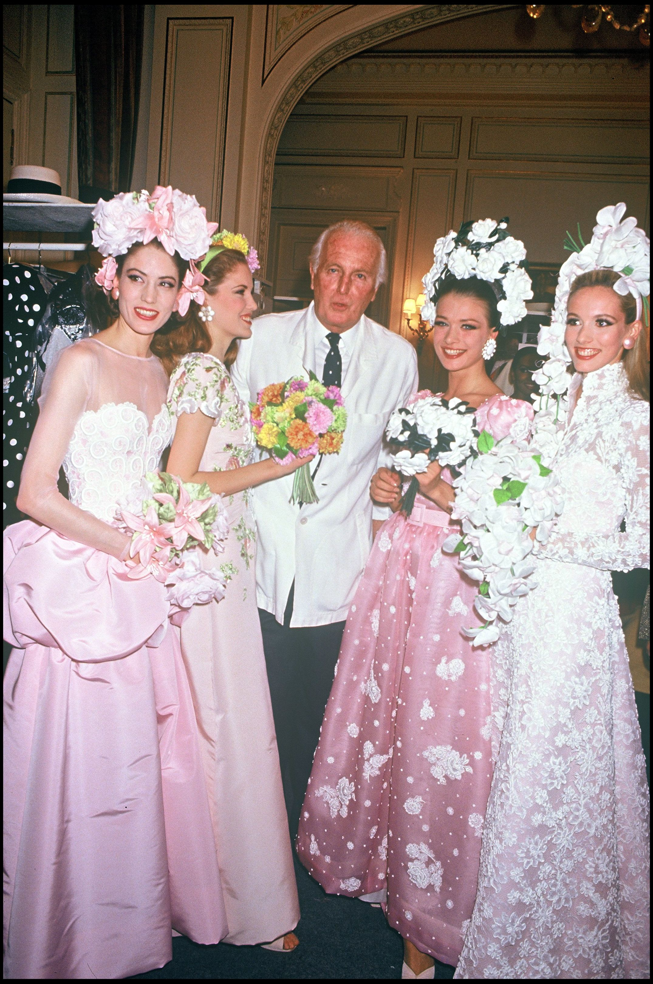 Givenchy with models wearing designs from his spring/summer 1992 couture collection.