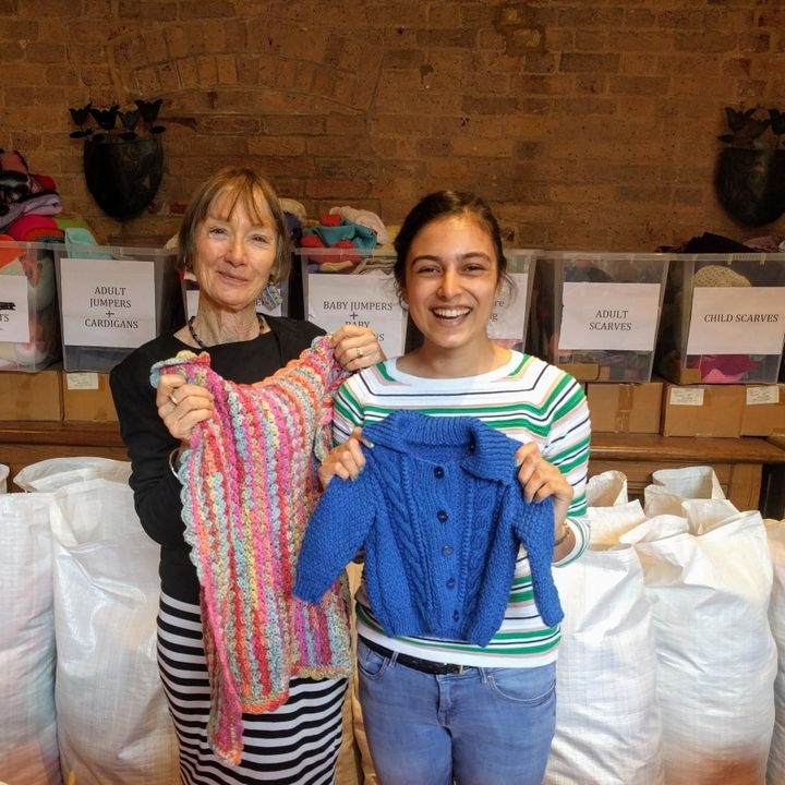 Volunteers sort out donations at Knit For Peace HQ
