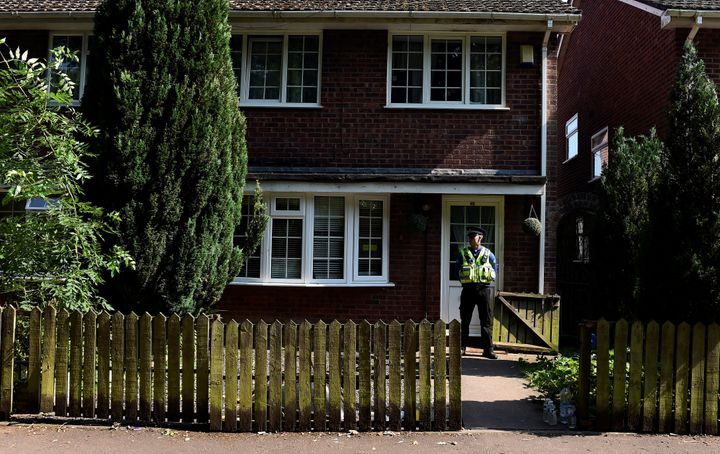 A police officer stands outside the home of Darren Osborne, in Cardiff, Wales, on June 20, 2017. He was convicted of driving