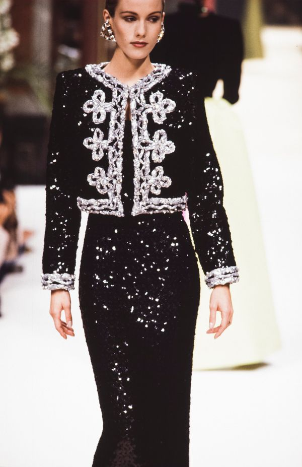 A model walks the runway at the Givenchy fall/winter 1992-1993 couture show during Paris Fashion Week in July 1992.