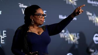 """Cast member Oprah Winfrey poses at the premiere of """"A Wrinkle in Time"""" in Los Angeles, California, U.S., February 26, 2018.  REUTERS/Mario Anzuoni"""
