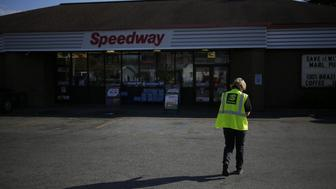 An employee walks through the parking lot of a Marathon Petroleum Corp. Speedway gas station in Huntington, West Virginia, U.S., on Tuesday, Oct. 18, 2016. Marathon Petroleum Corp. is scheduled to release earnings figures on October 27. Photographer: Luke Sharrett/Bloomberg via Getty Images