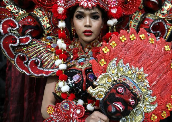 Contestant Dinda Syarif of Indonesia gets ready for an appearance.