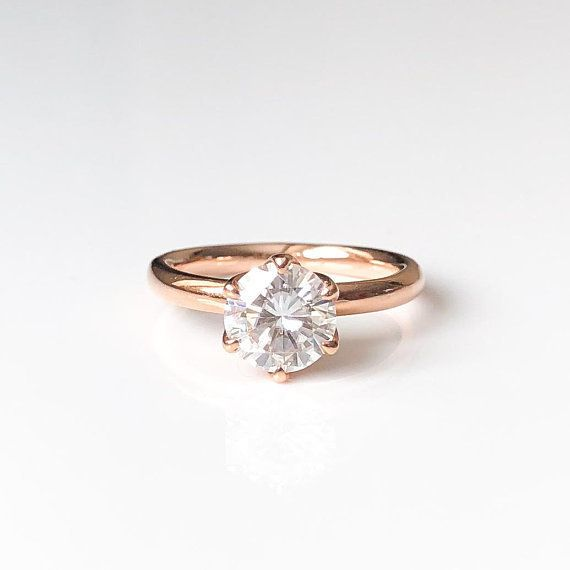 "<i><a href=""https://www.etsy.com/listing/598669151/round-moissanite-engagement-ring-forever?ref=shop_home_active_11"" target="""