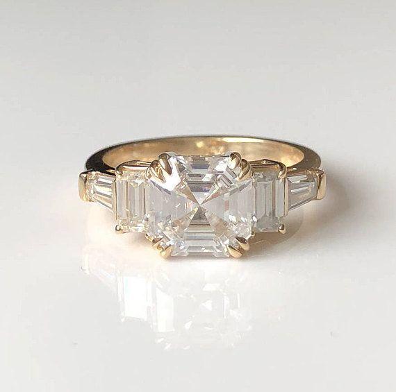 "<i><a href=""https://www.etsy.com/listing/582844756/asscher-cut-moissanite-engagement-ring?ref=shop_home_active_18"" target=""_b"