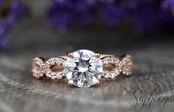 """<i><a href=""""https://www.etsy.com/listing/555462738/moissanite-engagement-ring-in-14k"""" target=""""_blank"""">Buy it fromSaphee"""