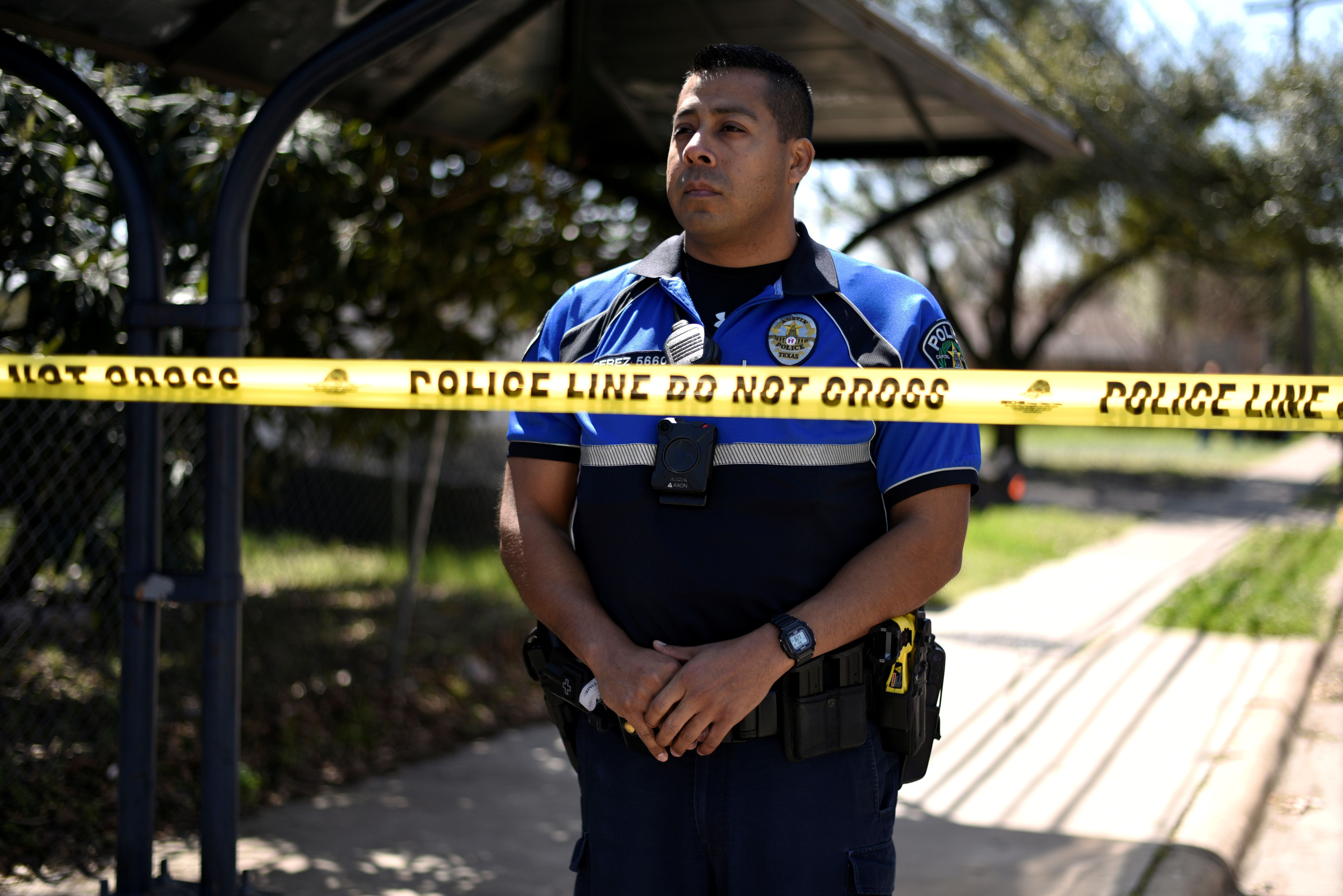 A police officer guards the scene of an explosion on Galindo Street in Austin, Texas, U.S., March 12, 2018. REUTERS/Sergio Flores