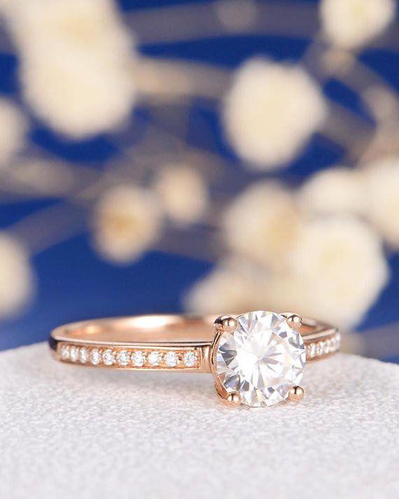 "<i><a href=""https://www.etsy.com/listing/532505919/moissanite-engagement-ring-rose-gold?ref=shop_home_active_26"" target=""_bla"