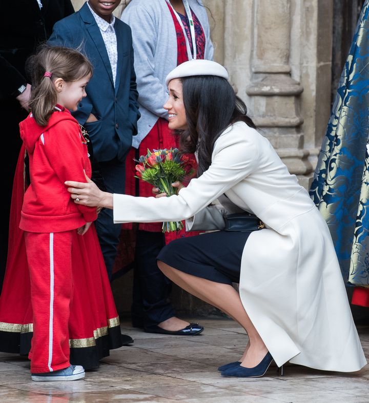 The soon-to-be duchess crouched down to meet a young fan.
