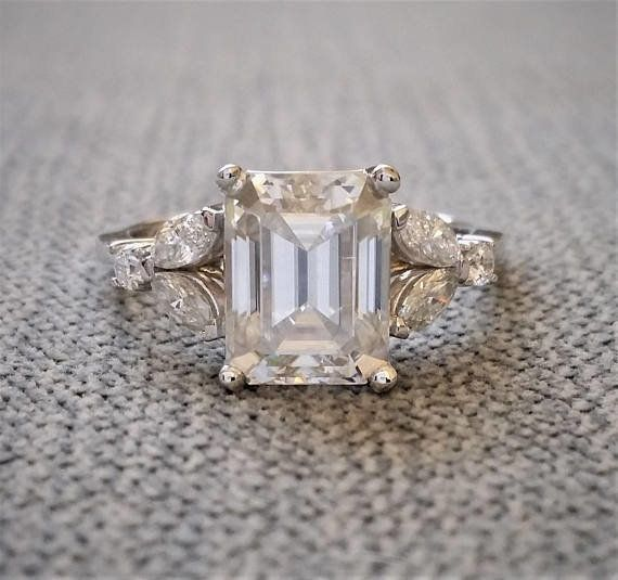 """<i><a href=""""https://www.etsy.com/listing/593633605/antique-ef-color-moissanite-engagement?ga_search_query=moissanite&ref="""