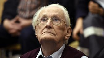 """Oskar Groening, defendant and former Nazi SS officer dubbed the """"bookkeeper of Auschwitz"""", listens to the verdict during his trial in Lueneburg, Germany, July 15, 2015. The 94-year-old German man who worked as a bookkeeper at the Auschwitz death camp was convicted on Wednesday of being an accessory to the murder of 300,000 people and was sentenced to four years in prison, in what could be one of the last big Holocaust trials, Lueneburg, Germany, July 15, 2015. REUTERS/Axel Heimken/Pool"""