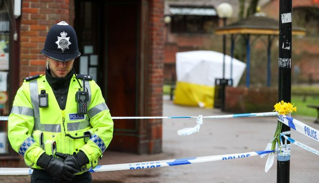 A police officer stands in Salisbury near the bench where the Skripals were