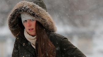 A woman walks through Boston Common during a winter snow storm in Boston, Massachusetts, U.S., January 17, 2018.   REUTERS/Brian Snyder