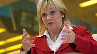 Mary Fallin, Republican Governor from Oklahoma, speaks during an interview in New York, U.S., on Thursday,Aug. 18, 2011. Fallin said in April her state would return $54 million to help set up an insurance exchange. Photographer: Scott Eells/Bloomberg via Getty Images