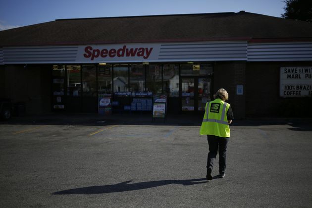 An employee walks through the parking lot of a Marathon Petroleum Corp. Speedway gas station in Huntington,...