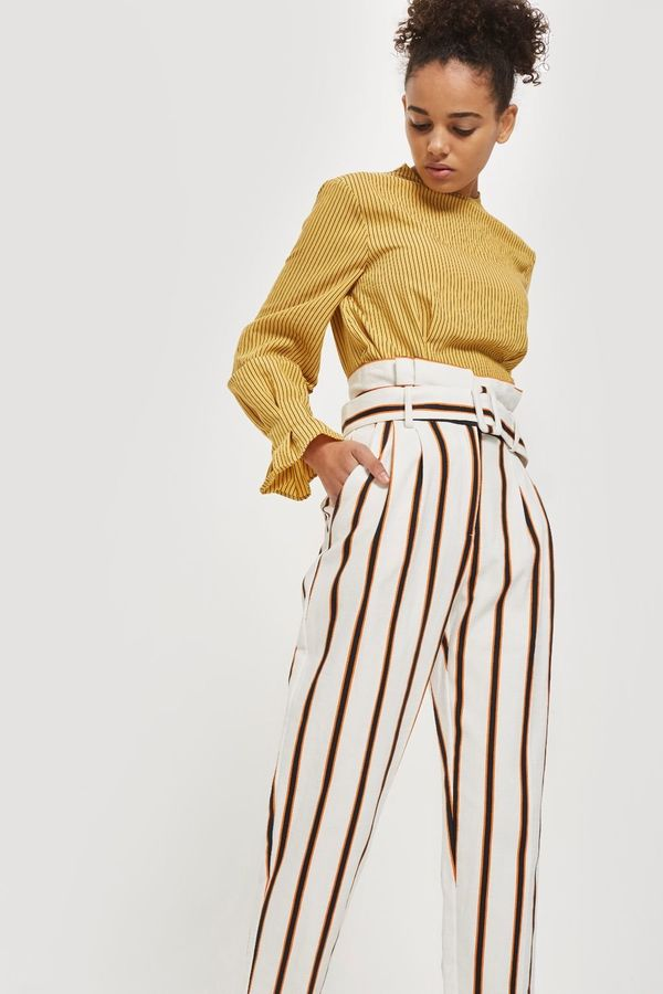 """Get them at <a href=""""http://us.topshop.com/en/tsus/product/multi-coloured-stripe-tapered-trousers-7490514?bi=20&ps=20"""" ta"""