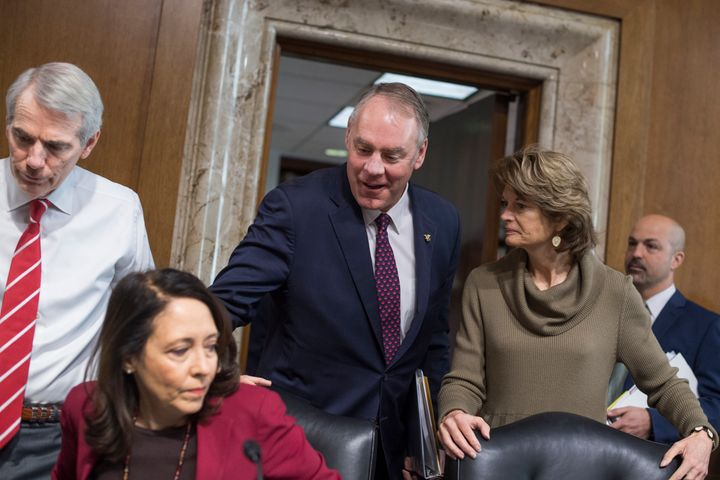 Interior Secretary Ryan Zinke, center, arrives to testify at a Senate Energy and Natural Resources Committee hearing on Tuesd