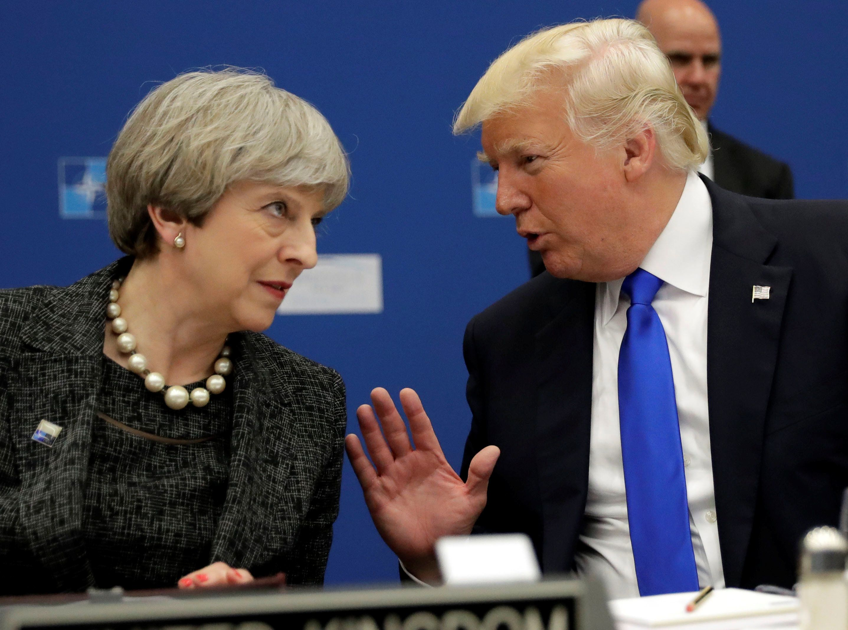 U.S. President Donald Trump (R) speaks to Britain's Prime Minister Theresa May during in a working dinner meeting at the NATO headquarters during a NATO summit of heads of state and government in Brussels, Belgium, May 25, 2017.     REUTERS/Matt Dunham/Pool
