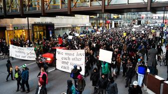 Members of the group Black Lives Matter march to city hall during a protest in Minneapolis, Minnesota November 24, 2015. Police are searching for three white men in connection with the shooting of five people near a Minneapolis police station where demonstrators have gathered for more than a week to protest the fatal shooting of an unarmed black man -- Jamar Clark -- by police on November 15.   REUTERS/Craig Lassig