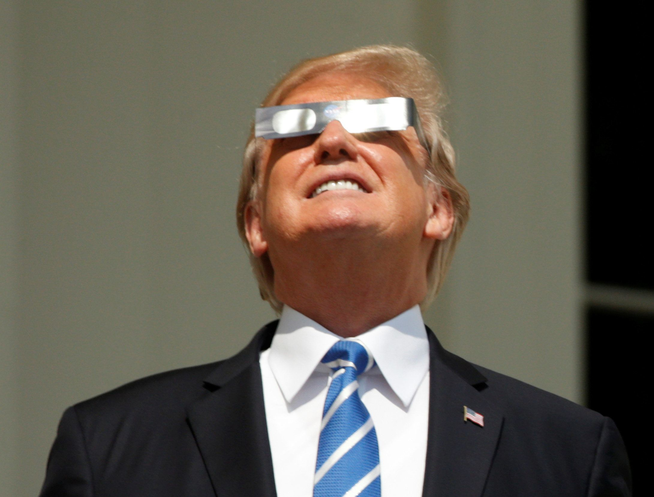 U.S. President Donald Trump watches the solar eclipse from the Truman Balcony at the White House in Washington, U.S., August 21, 2017. REUTERS/Kevin Lamarque