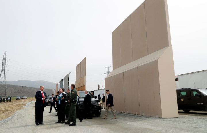 President Donald Trump tours U.S.-Mexico border wall prototypes near the Otay Mesa Port of Entry in San Diego.