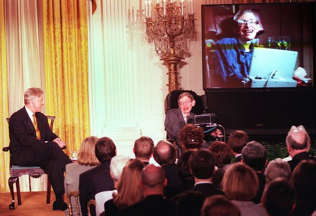 Hawking with Bill Clinton at a White House screening of a scene from'Star Trek the Next Generation'...