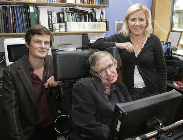 Professor Stephen Hawking, (C) his daughter Lucy (R) and Christophe Galfard pose for photographs in Professor...