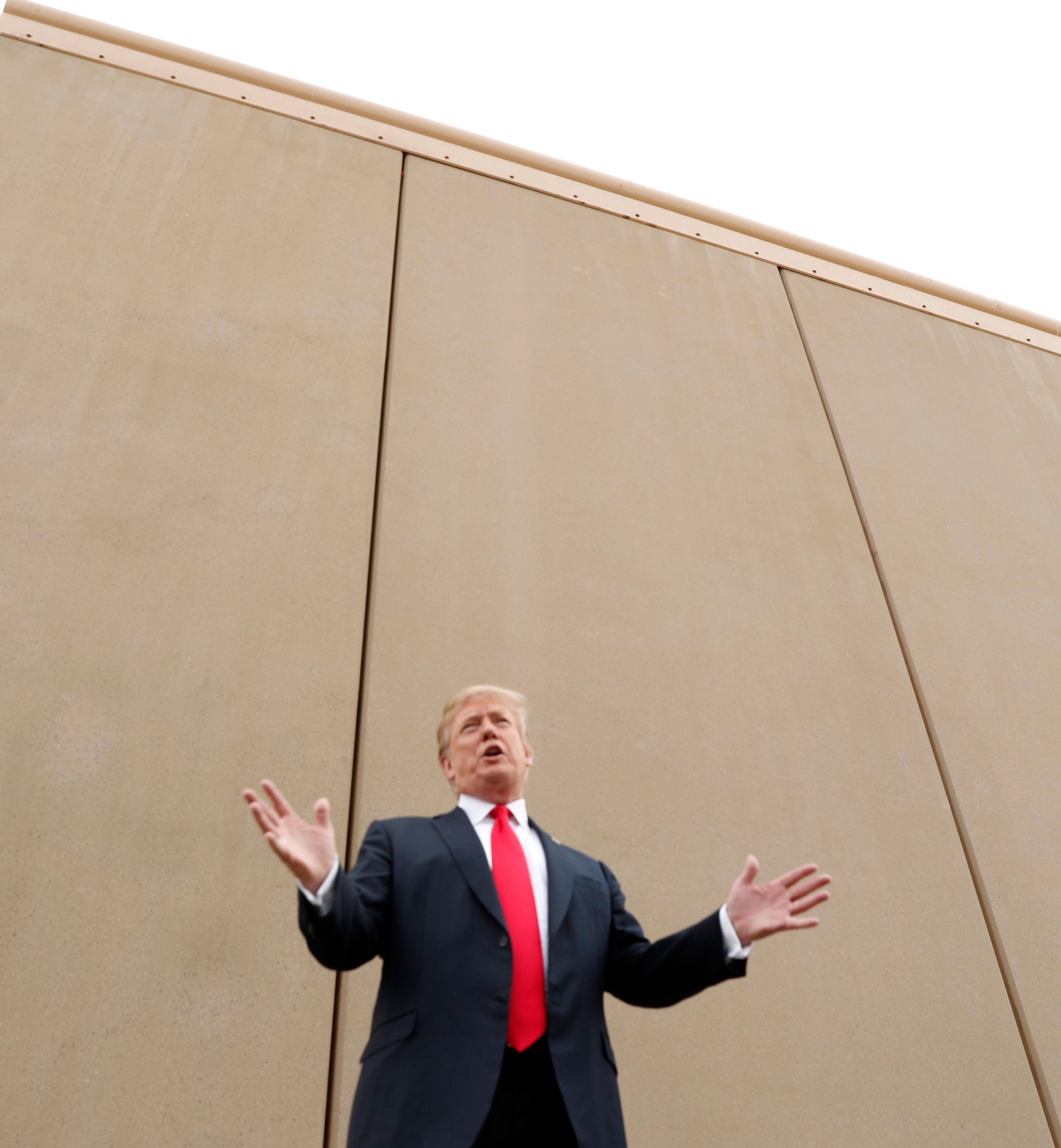 U.S. President Donald Trump speaks while participating in a tour of U.S.-Mexico border wall prototypes near the Otay Mesa Port of Entry in San Diego, California. U.S., March 13, 2018. REUTERS/Kevin Lamarque