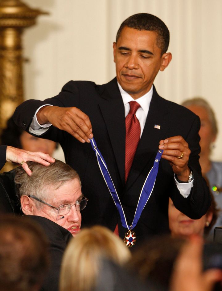 President Barack Obama presents the Medal of Freedom to scientist Stephen Hawking during a ceremony in the East Room of the White House in Washington, August 12, 2009.