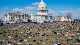 TOPSHOT - The lawn outside the US Capitol is covered with 7,000 pairs of empty shoes to memorialize the 7,000 children killed by gun violence since the Sandy Hook school shooting, in a display organized by the global advocacy group Avaaz, in Washington, DC, March 13, 2018. / AFP PHOTO / SAUL LOEB        (Photo credit should read SAUL LOEB/AFP/Getty Images)