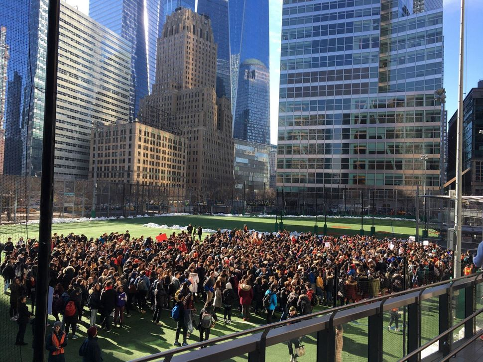 Students from Stuyvesant High School walk out in New York City.
