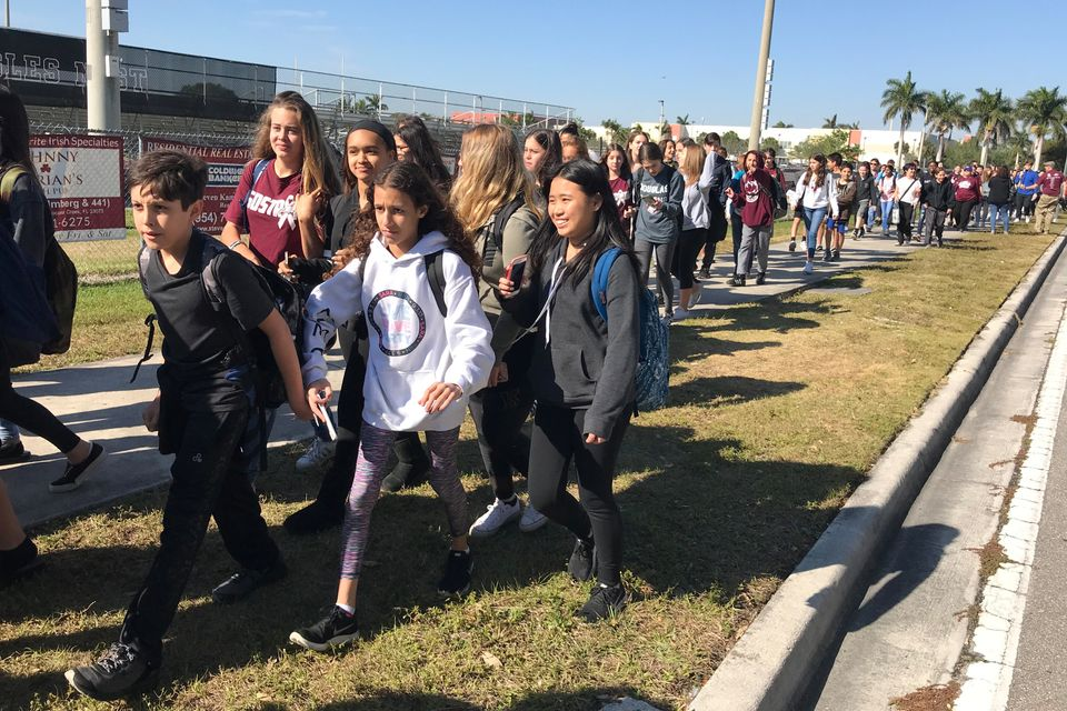 Students walk out at Marjory Stoneman Douglas High School during the National School Walkout to protest gun violence in Parkl