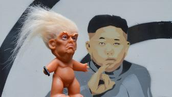 A vinyl doll which features President Donald Trump, made by a former sculptor for Disney, Chuck Williams, placed near a satiric painting of supreme leader of North Korea, Kim Jong-un, painted by Irish artist Solus. Donald Trump Troll dolls can be seen and bought at Balla Ban Art Gallery in Dublin city center. On Wednesday, 24 October 2017, in Dublin, Ireland. (Photo by Artur Widak/NurPhoto via Getty Images)
