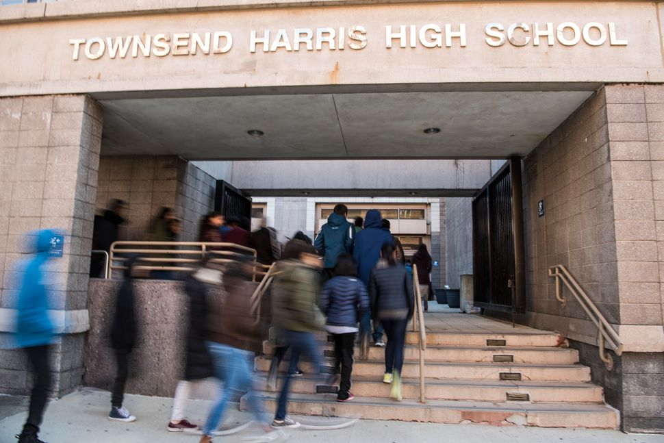 Students of Townsend Harris High School enter their school after taking part in a nationwide student walkout.