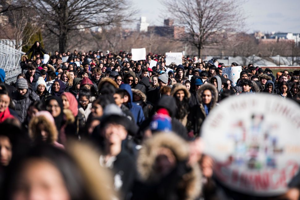 Students of Townsend Harris High School in Queens, New York, take part in a nationwide student walkout in solidarity with oth