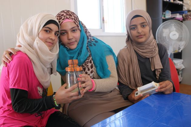 From left to right: Esmaa, Shorouq, Nour – the girls that made a food blender out of recycled materials....