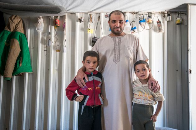 Abu Ahmad helped another community member, Mustafa, install a sunshade. In exchange he and his sons got...