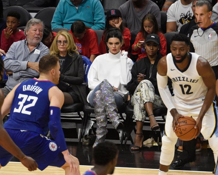 Kendall Jenner watches Blake Griffin play courtside.