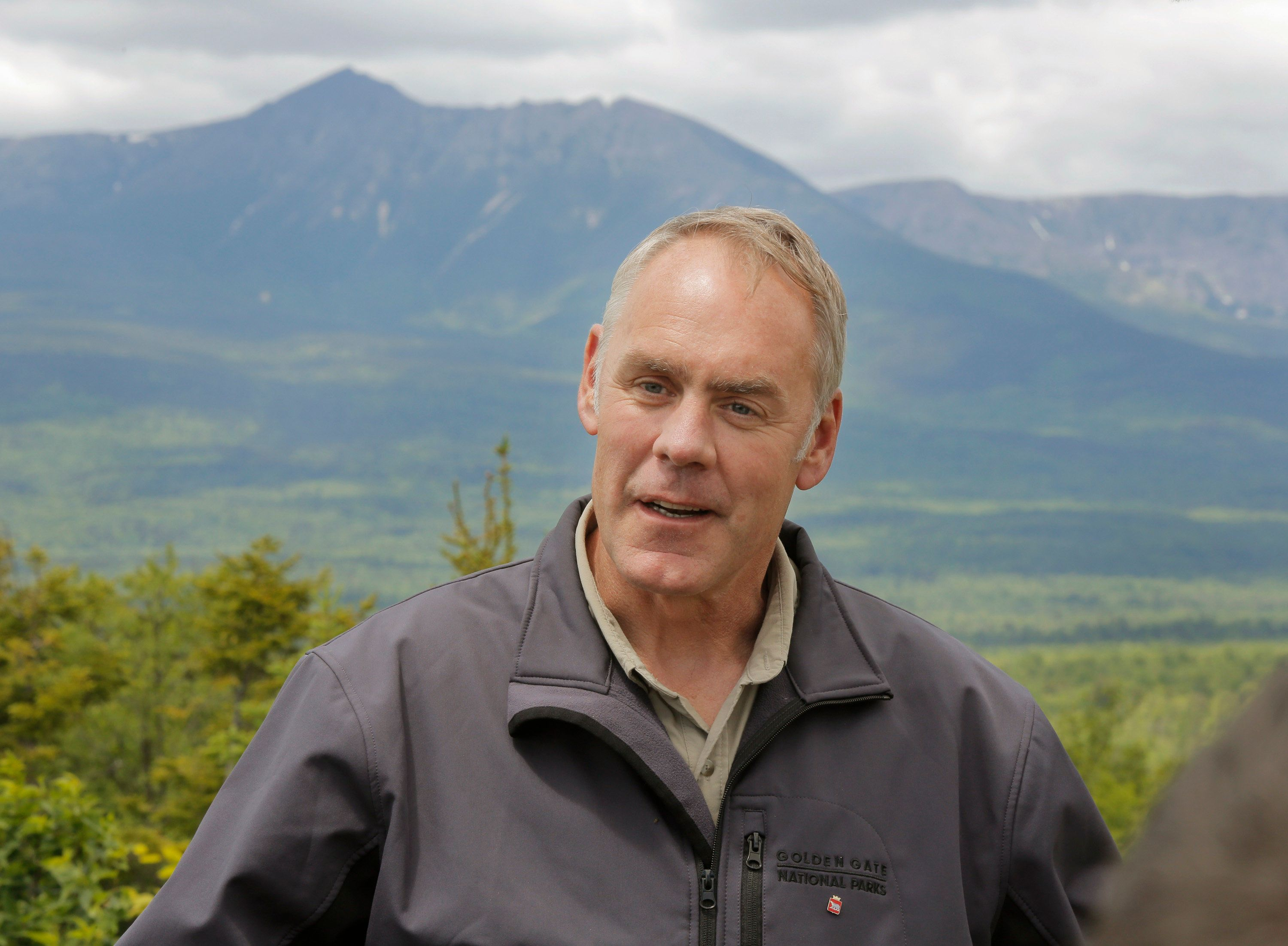 KATAHDIN WOODS AND WATERS NATIONAL MONUMENT, ME - JUNE 14: With Mount Katahdin in the background, Interior Secretary Ryan Zinke talks to the media during a tour of the Katahdin Woods & Waters National Monument on Wednesday, June 14, 2017. Zinke was touring the monument because it is one of dozens of monuments up for review under an executive order from President Trump. (Staff Photo by Gregory Rec/Portland Press Herald via Getty Images)
