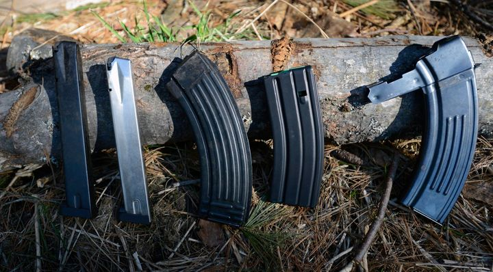 A variety of high-capacity magazines. The two on the left are magazines for handguns, while the next three are for milit